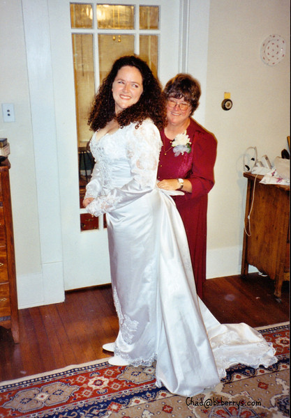 Judy and Kelly's wedding- Mom helps with gown