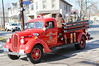 Original fire truck rides visitors from the house to convention site.