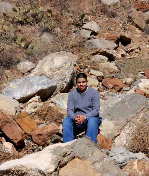 Marcus taking a break on our hike at the Franklin Mountains State Park.