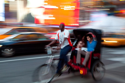 Bicycle rickshaws in the traffic.