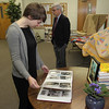 An open gathering was held at Cedar Lake Church of the Brethren prior to the memorial service for Anna Ruth Haynes.  On display are photographs, albums, quilts, paintings and other artwork by Anna Ruth, here being reviewed by Ellen Knechel and in the background David Knechel.
