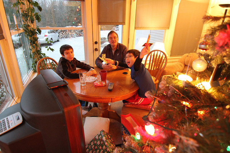 UNO card sharks play a few rounds by the Christmas Tree.