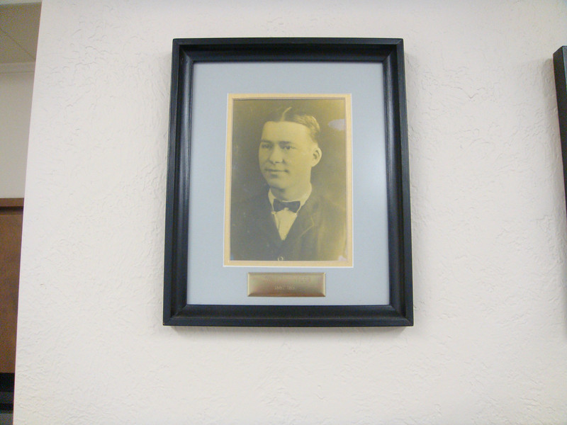 Photo of picture frame of Philip Amsler on wall of mayors at Chamber of Commerce in Shiner.