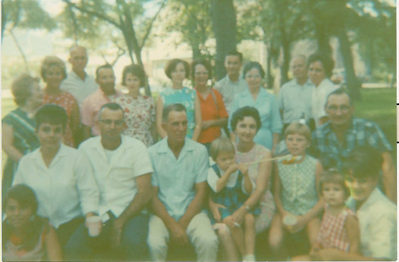 """Family gathering at Breckenridge park about July 1965.  A story we heard was that passengers on  the small railroad that circled the part had been robbed on that day. So later I looked up the story and found :""""She told me that when she was in her early teens, a couple of guys rented some horses from a nearby stable, dressed themselves as cowboys, rode over to some spot good for an ambush and robbed the train, took all the passengers valuables and rode off. The passengers thought it was a stunt, a show, a part of the train ride""""  ..that our family had heard before we left the park.  Some had intended to ride if time : )"""