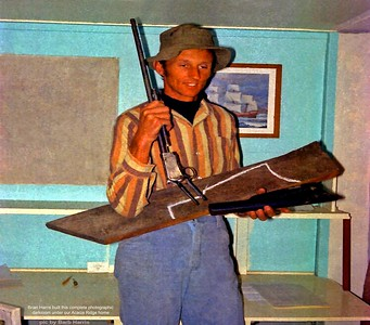Brian and an old Winchester pump action .22 rifle that army mate Speed (eric) Burton gave him. Brian made a wood stock with a brass shoulder plate for it.
