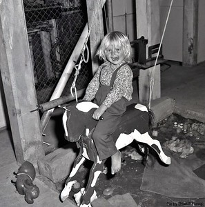 Jillian Ison on our horse handed down from our family. Under our Acacia Ridge house. That section yet to be concreted as dollars available
