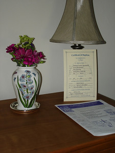 The baptismal certificate.