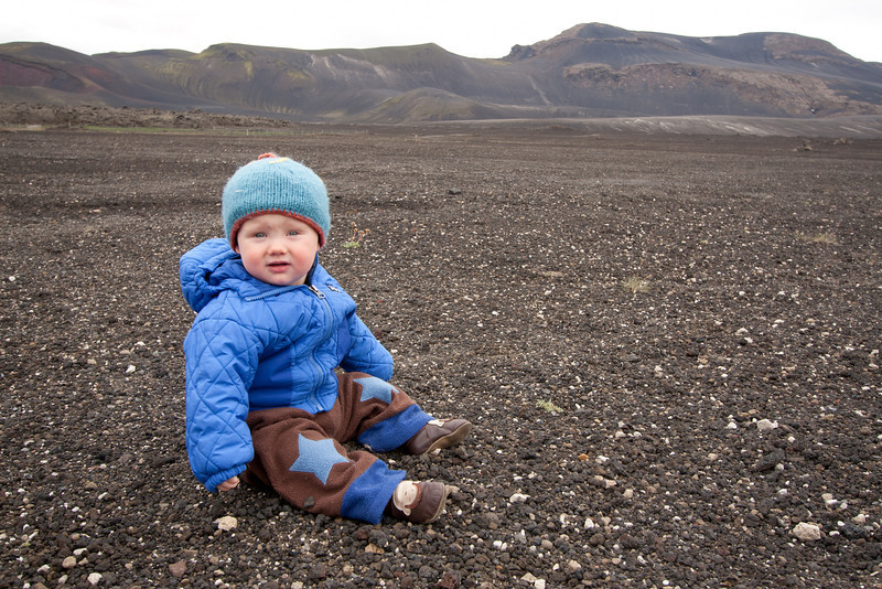 <b>15.8.2012</b> A stop off near Hekla on the bus trip from Reykjavik to Landmannalaugar.  Finn liked the rocks.