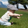 <b>9.5 months</b> Hanging out in the park by the river - he kept leaning forwards like this, then pulling back, not keen to crawl on the funny grass