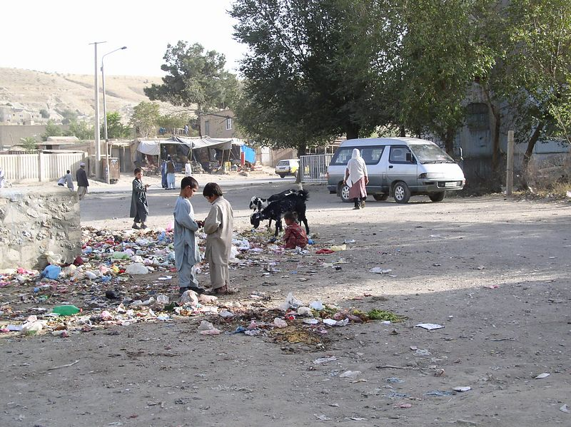 """Prevention. These children share a garbage dump with two goats - rummaging through for items of interest. This was taken in one of the """"better neighborhoods"""". Opportunities for reliable food sources, education and play areas will prevent the foraging, spread of disease and risk of injury.<br /> """"The highest reward for a man's toil is not what he gets for it but what he becomes by it."""" John Ruskin"""