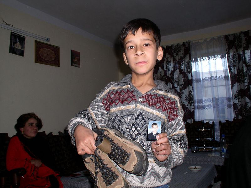 """After a successful shoe-donation drive, Afghan children had an opportunity to """"picK' a pair of sturdy shoes. Ali is 12 and has cerebral palsy. He cannot speak, but is great on the computer, understands English perfectly and is a good dancer>"""