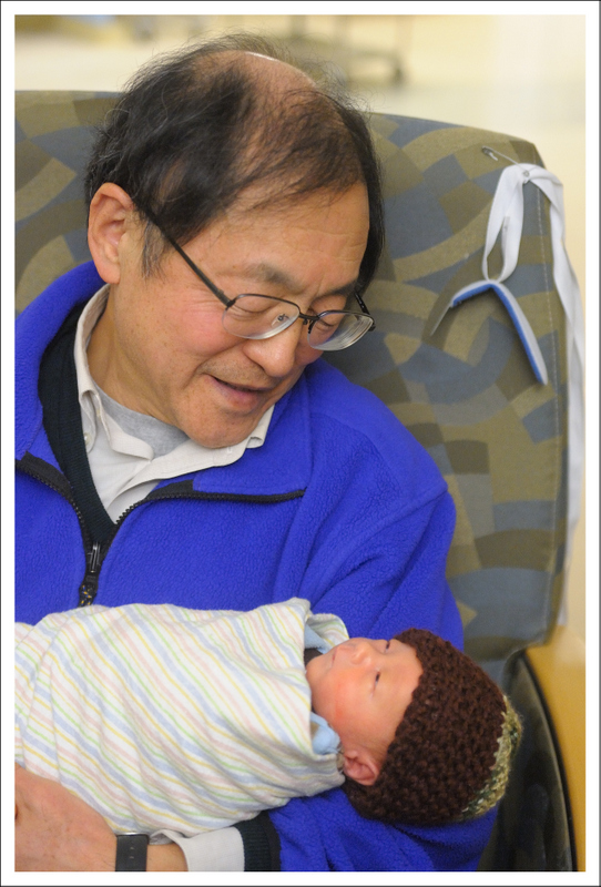 Grandpa's last chance to hold Tyler before returning to Tokyo.