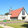 Dad in front of our old church in Windom.