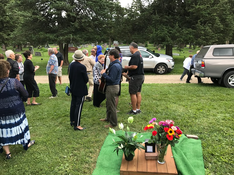 Gathering around the grave site after the Ceremony, Kim, Pat, Buck and Mark.