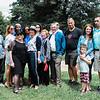 Lee, Heather, Odell, Mom, Jasmine, Kim, Ann, Pat, Alan, Andrew (partially hidden} Mark, Faith with Eli and Alex holding Malachi