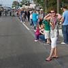 Kim collecting Madigras beads at the Panama City Madigras parade.