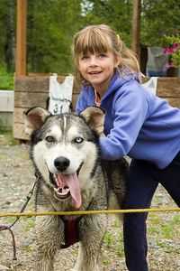 Sara enjoying the sled dogs.