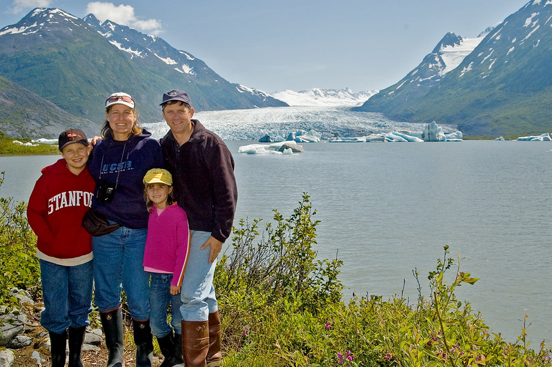 The four of us standing in front of a lake.  In the background you can see a glacier that runs into this lake.  The lake it barely above freezing.  If you fell into the lake, you'd survive only a few minutes before hypothermia would set in.