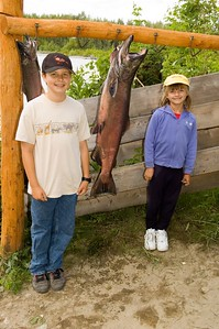 "This is Kevin and Sara standing next to the 41 pound kind salmon that someone else in our fishing group caught.  We were planning to ""catch and release"" any salmon that we caught, but the fisherman who caught this salmon was having it filletted and sent back home packed in dry ice."