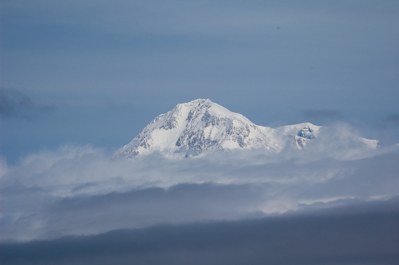 The top of Mount McKinley as seen from the air.  20,320 feet high.  The tallest mountain in North America.  Most of the time, you can't see the mountain from the ground because it's obscured by clouds.  Apparently, you most often see it in the wintertime after a big storm has cleared through, but before the normal clouds form again.
