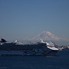 The Norwegian Pearl leaving Seattle at the same time. We saw it again in Victoria BC, docked alongside us, on the way back. <br /> Mt. Rainier in the background