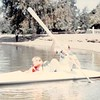 April 1984<br /> Vasona Lake (near Los Gatos, CA)<br /> Teresa (5) and Bob in boat. Kent's pulling in boat and Mom M. is in background.