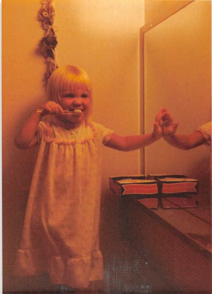 August 1981<br /> 1484 S. 400 e. Orem, UT<br /> Teresa (2 1/2) showing us how she brushes her teeth.