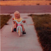 August 1981<br /> 1484 S. 400 E. Orem, UT<br /> Teresa (2 1/2) riding her hot wheels.