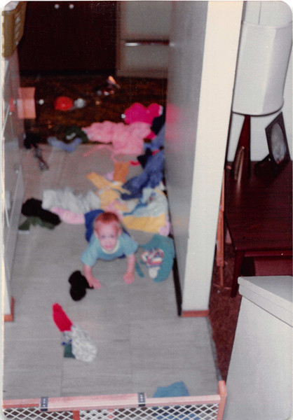 Nov. 1981<br /> 144-D Escondido Village, Stanford, CA<br /> Craig (one year) scattering the laundry.
