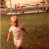 July 1981<br /> SLC, UT at Meakin Reunion<br /> Teresa (almost 2 1/2 yrs.) running through the rain.