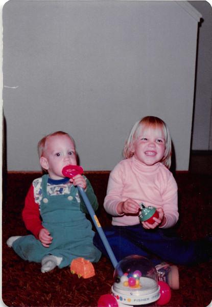 Nov. 23, 1981<br /> 144-D Escondido Village, Stanford, CA<br /> Craig's first birthday.  <br /> Craig and Teresa (2 1/2) showing us Craig's birthday presents.