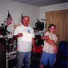 """July 1994<br /> 262 Marich Way, Los Altos, CA<br /> Bob & Craig after arriving home from all week scout trip to Mammoth--they're dirty (paper Bob is holding says--""""Engineer of the Year"""")"""