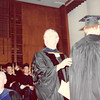 April 18, 1980<br /> convocation in JSB auditorium<br /> Dr. Richard Hanks (Chemical Eng. chairman and also my boss when I was dept. secretary there) and Dr. James Barton (Civil Eng. chairman).  Bob's back after receiving diploma cover.