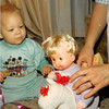 Christmas morning 1979 <br /> Tustin, CA<br /> Teresa watching her new dolly on the rocking horse.