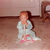 Dec. 1979<br /> 262 Marich Way, Los Altos, CA<br /> Teresa (10 months old) playing with grandma's jewelry.