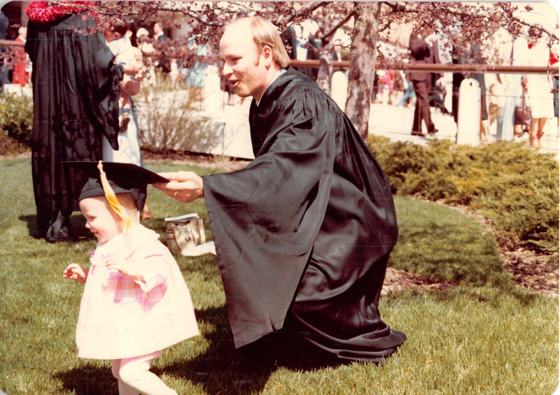 April 18, 1980<br /> Bob chasing Teresa as she escapes with his hat after commencement exercises in Marriott Center.