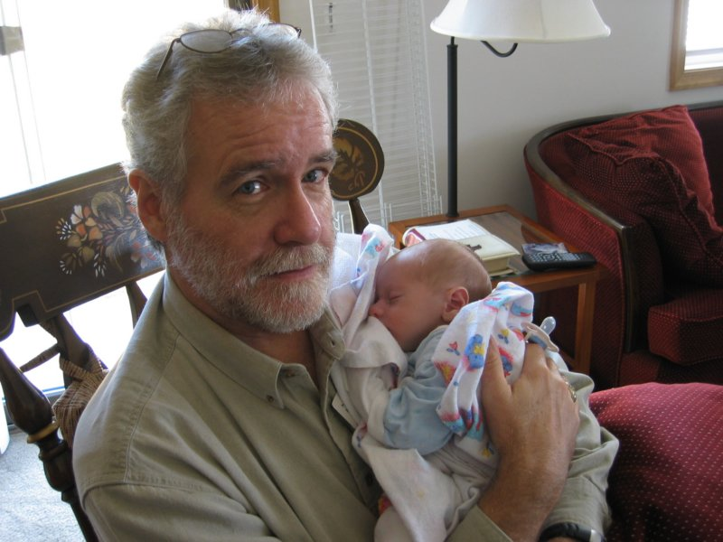 Now it is time to settle down to some serious cuddling of the grandson.