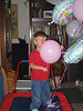 Alex has a seriously good time with the balloons from Sarah's shower for Miranda.