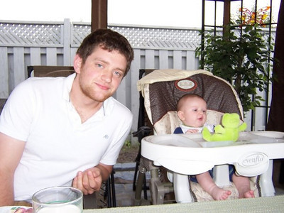 Alex's 21st birthday dinner - Evan in his highchair - backyard of 14 Palling Lane