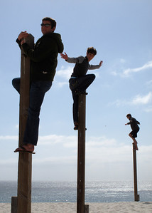 alex chase and brent on poles at beach