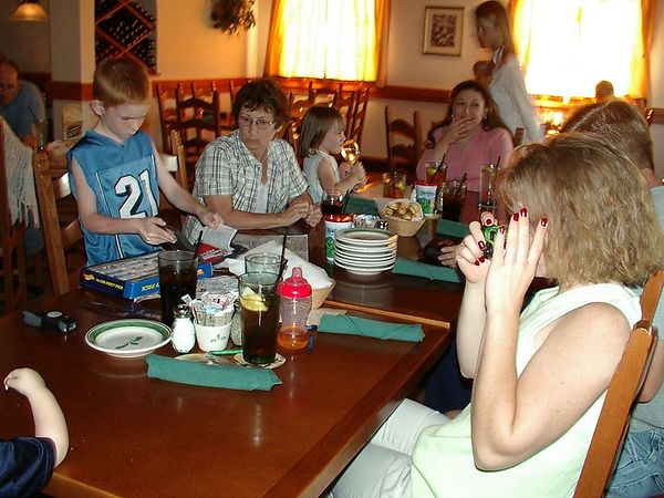"""<br><br><font size=""""3"""">Mom takes a picture of Alex opening his presents.</font>"""