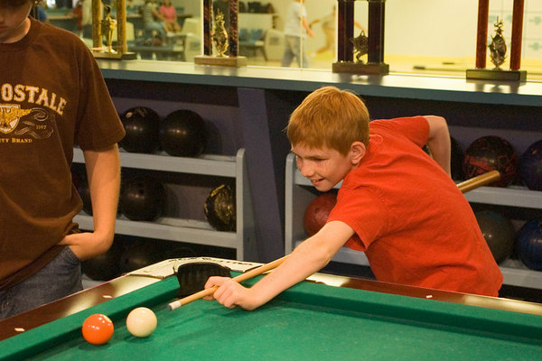 """<font size=""""3"""">The boys enjoyed the pool tables.</font>"""
