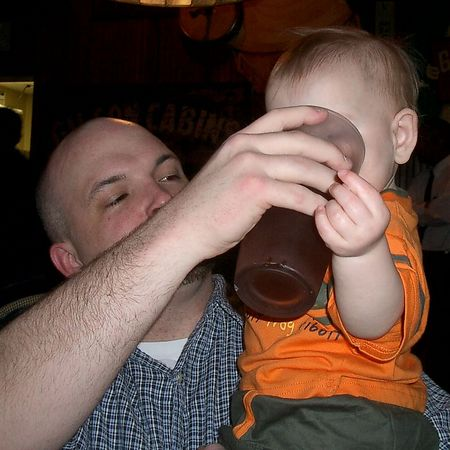 "<br><br><font size=""3"">Uncle Eric helps out with a drink from a very large glass.</font>"