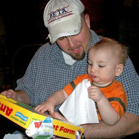 """<br><br><font size=""""3"""">Eric shows his present to Jacob.  The little guy seems more interested in the wrapping paper.</font>"""