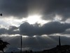 Beautiful sunbeams around the clouds.