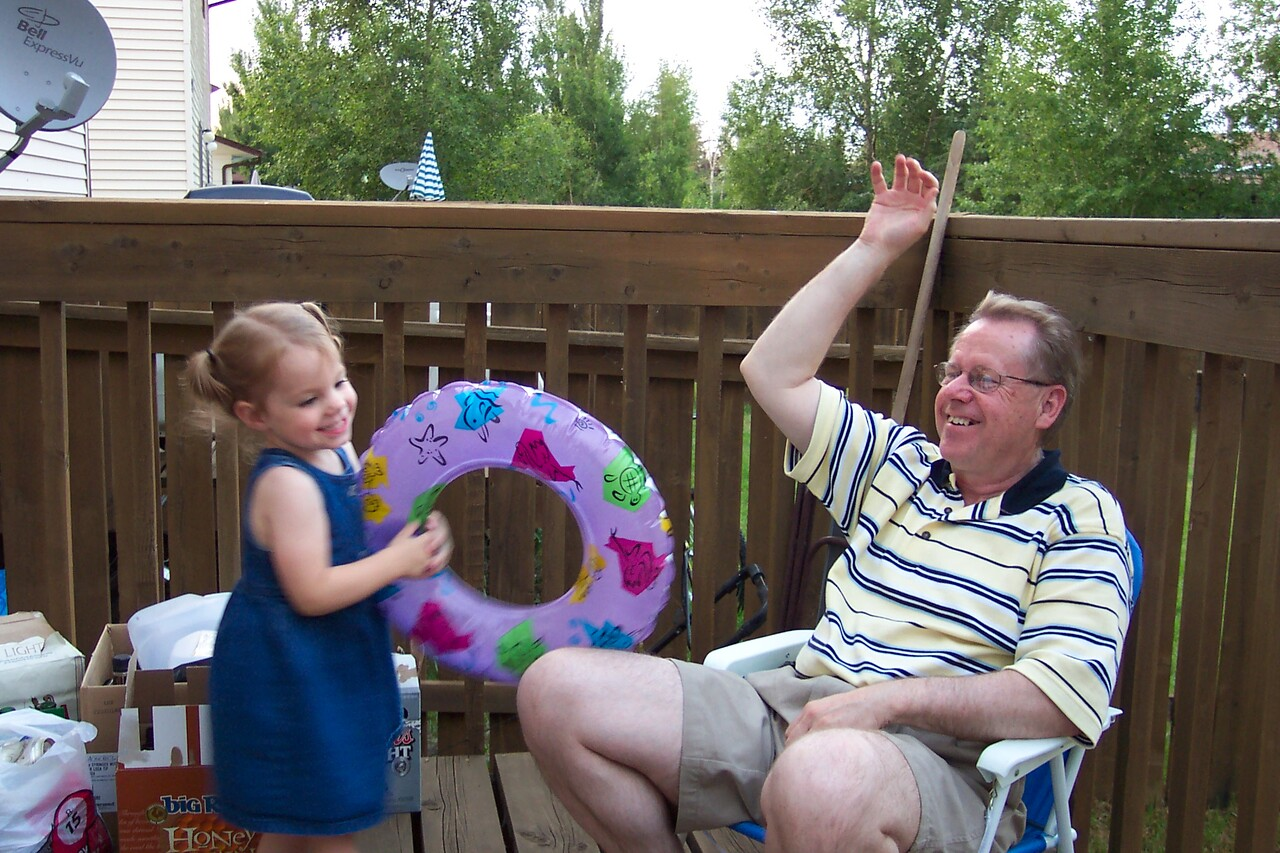Reese and Dad playing in the back yard.