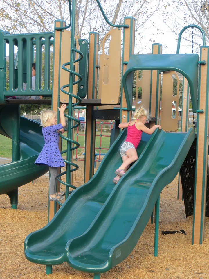On the playground with friend Kristen