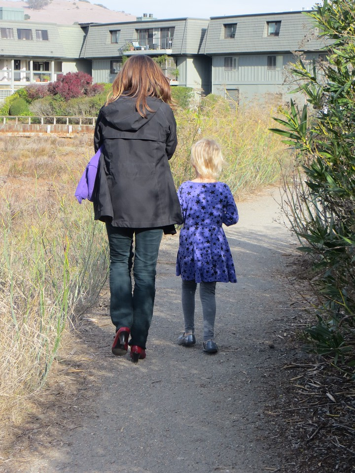 Rachel and Allegra taking a walk on a path near the water at school