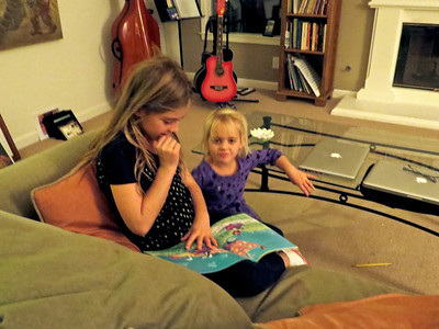 Sofia reading to her sister