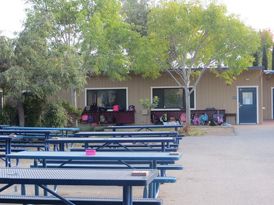 Note the cafeteria tables and area for coats - OUTSIDE at school.  It's the California thing.